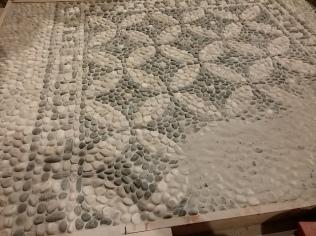 stuccatura mosaico di ciottoli