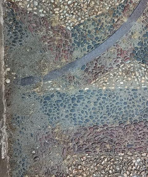 la sabbia sul mosaico di ciottoli